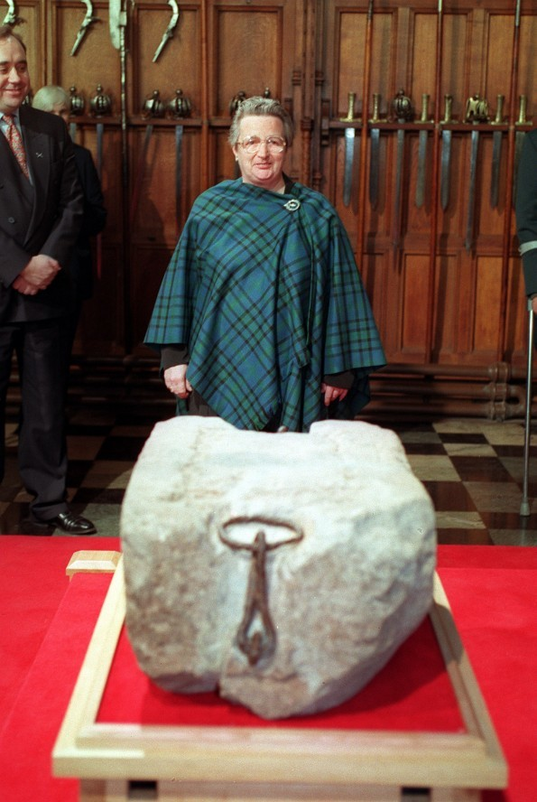 Kay Matheson, one of the four who stole the Stone of Destiny at Christmas 1950, welcomes the Stone back to Scotland during a ceremony at Edinburgh Castle.