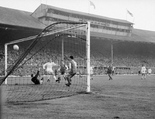 Real Madrid's Alfredo di Stefano (c) thrashes his team's second goal past Eintracht Frankfurt goalkeeper Egon Loy (PA Archive)