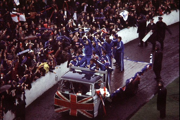 Rangers skipper John Greig parades the trophy around Ibrox