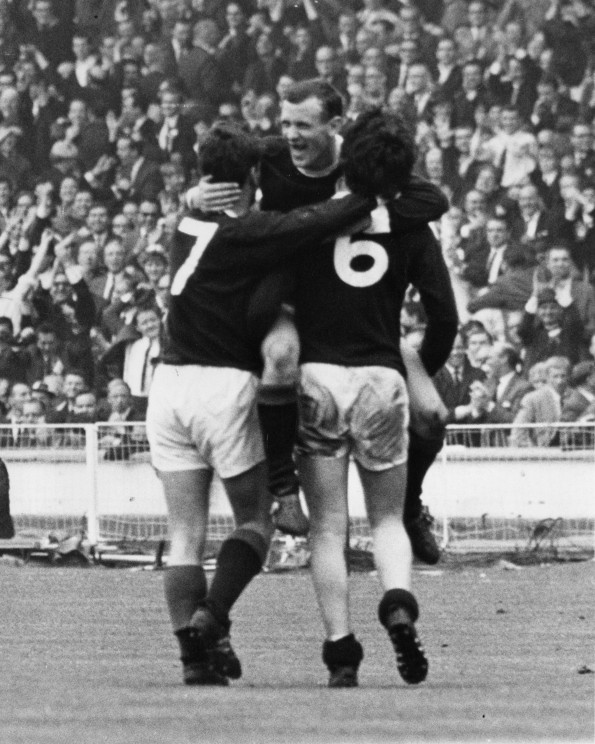 Bobby Lennox celebrates with team mates Willie Wallace (left) and Jim Baxter (Dennis Oulds/Central Press/Getty Images)