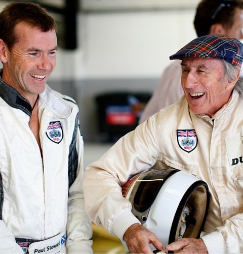 Former World Champion Sir Jackie Stewart and his son Paul Stewart share a joke