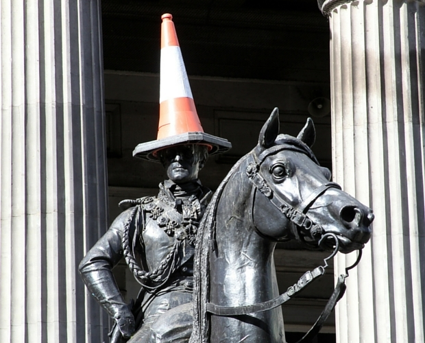 A traffic cone on the head of the Duke of Wellington statue