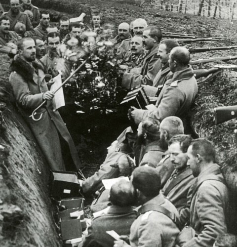 German troops take advantage of the unofficial ceasefire to sing seasonal songs in their trench (Alamy Stock Photo)