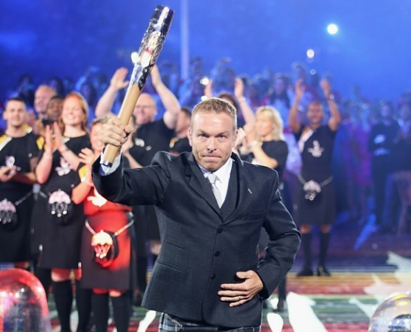 Sir Chris Hoy delivers the baton during the Opening Ceremony for the Glasgow 2014 Commonwealth Games